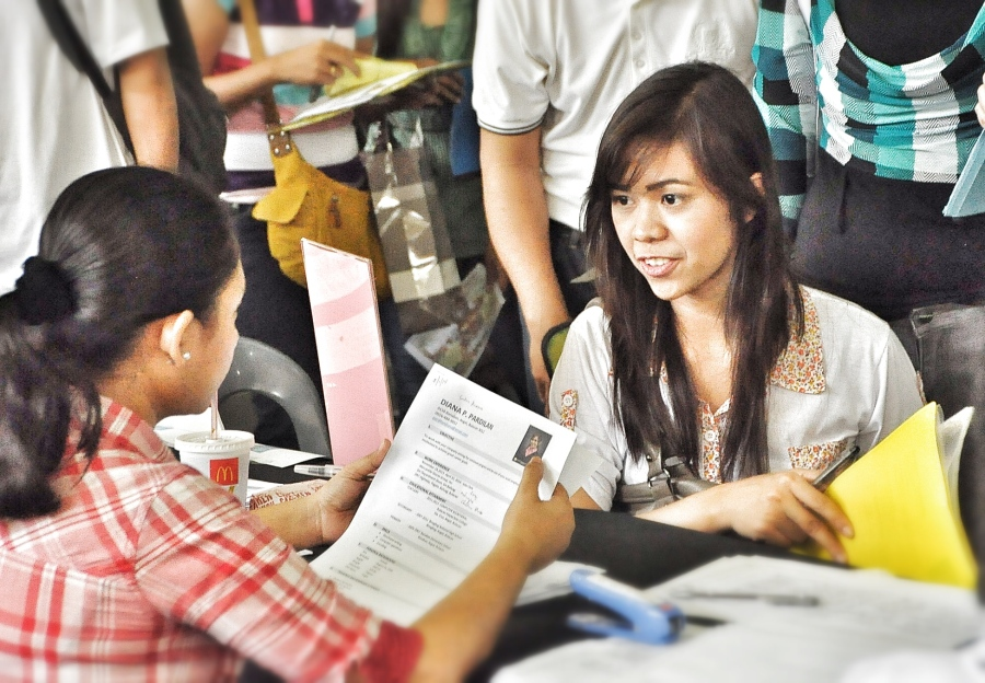 A young aspirant enthusiastically answers the interview questions during the Labor Day Job Fair in SM City Baliwag. Applicants who pre-registered and participated in DOLE's Pre-Employment Orientaton Seminar were given the advantage to go directly to their prospective employer for the interview without having to lineup with the walk-in applicants.