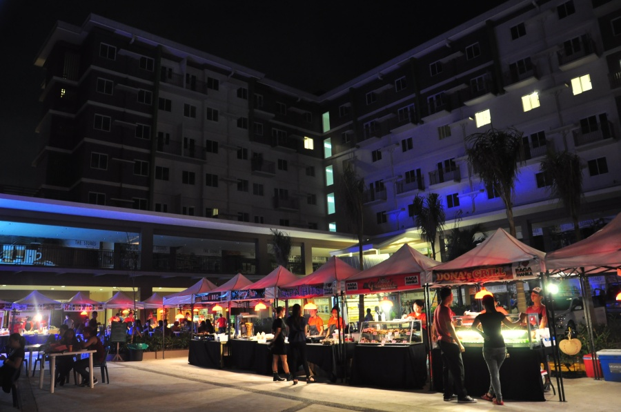 Food stalls offering mouth-watering grilled specialties set up in the retail area of Amaia Steps Sucat, awaiting homeowners and visitors.