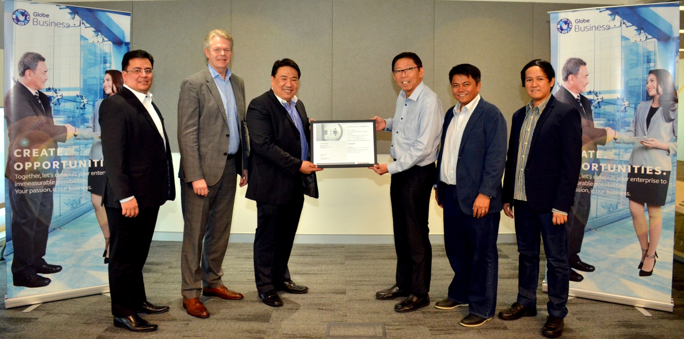 Globe Chief Technical Advisor Robert Tan (3rd from right) receives the Payment Card Industry Data Security Standard (PCI DSS) compliance certification version 3.2 for Globe Business from a representative of US-based Qualified Security Assessor Crimson Security, Inc. Other Globe officials who witnessed the awarding are (from L-R): Enterprise Sales Vice President Dion Asencio, Globe Business Senior Advisor Mike Frausing, Customer Systems Director Harry Florendo, and Info Security Governance Manager Paul Dumindin