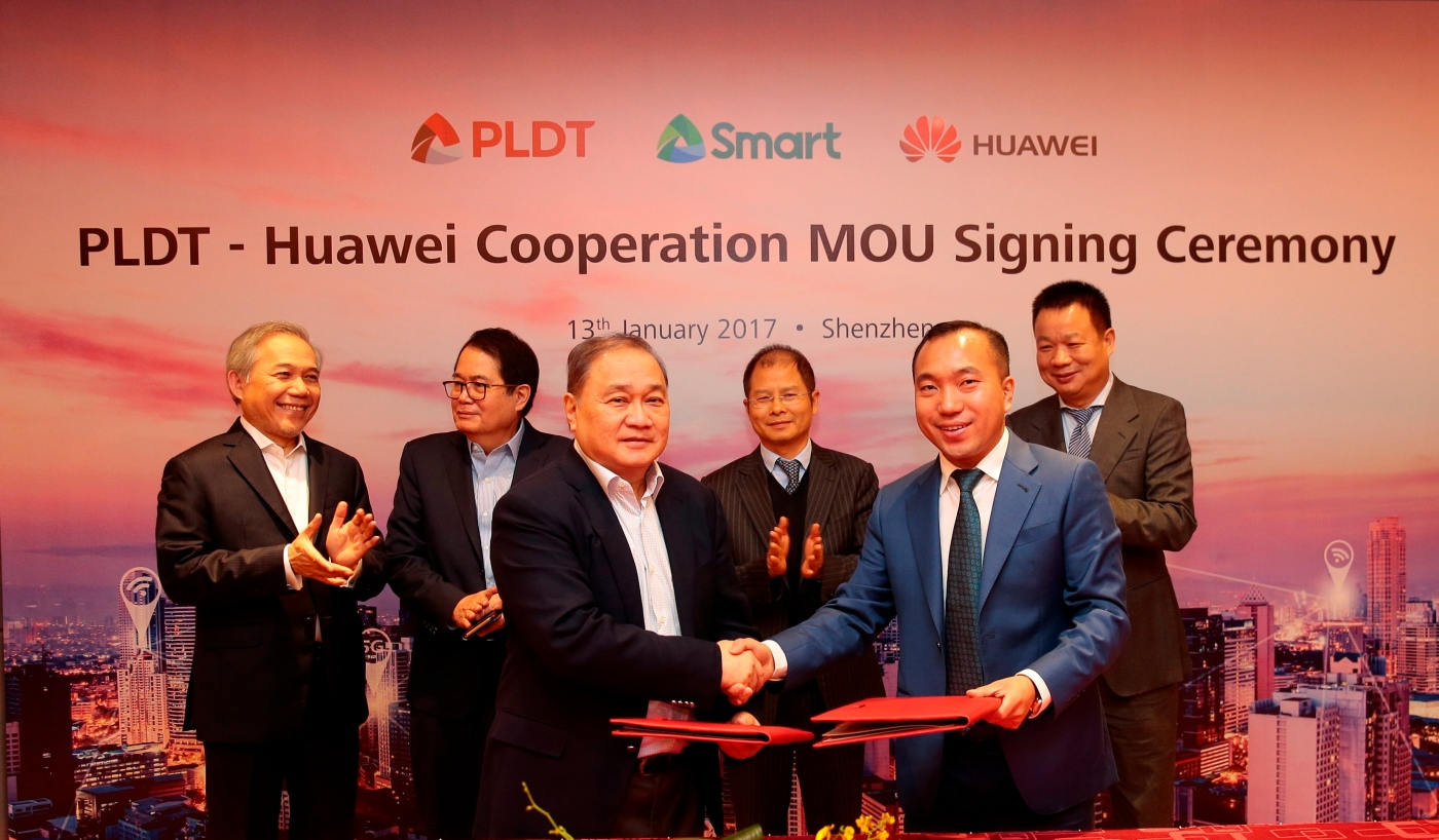 Photo shows (front row) PLDT and Smart Chairman, President, and CEO Manuel V. Pangilinan with Huawei Technologies Phils. Inc. CEO Jacky Gao Kexin after the MOU between PLDT/Smart and Huawei was signed, with (back row, from left) Atty. Ray C. Espinosa, Chief Corporate Services Officer at PLDT and Smart; Ricky Vargas, head of the Business Transformation Office of PLDT and Smart; and Eric Xu, rotating CEO of Huawei Corporation, and David Wei, President of Huawei South Pacific region, as witnesses.