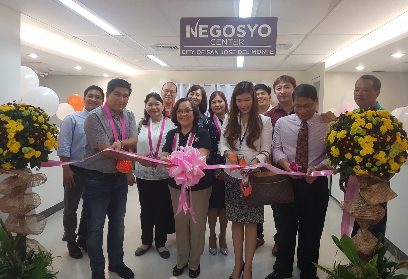 Launching of Negosyo Center. Gracing the ribbon cutting ceremony are (L-R) SJDM City Mayor Arthur Robes, DTI Regional Operations Group UndersecretaryZenaida C. Maglaya, SCMC SM Supermalls Regional Manager for Operations Lea B. Casamayor, SJDM City Administrator Dennis Booth, Ph.D.